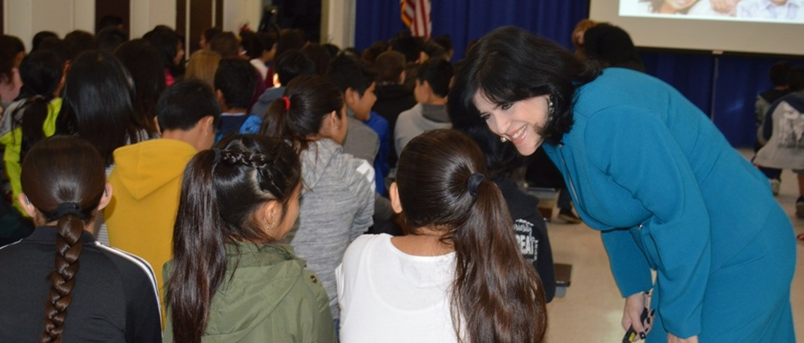 Superintendent Gabriela Mafi checks up on students during the assembly.